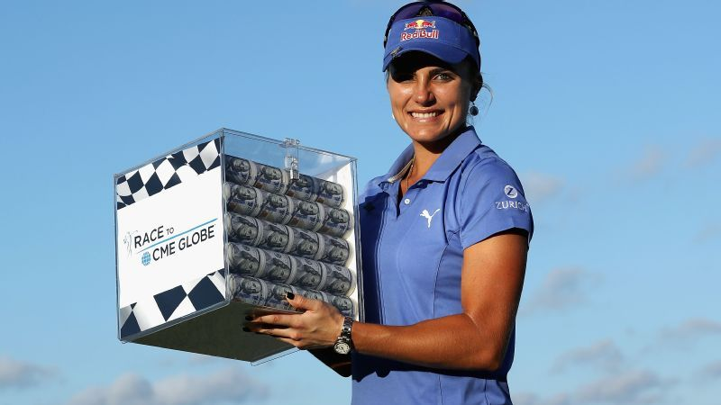 Lexi Thompson with trophy Race to the CME Globe at CME Group Tour Championship